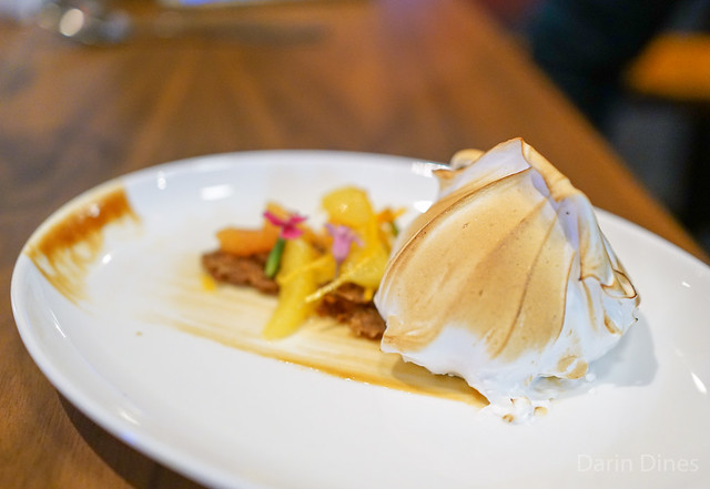 Baked Alaska with orange chocolate chip ice cream, cardamom tuile