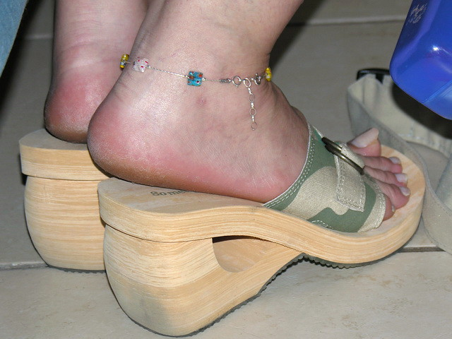 My mature MILF girlfriend is modeling her high heel wedge sandals, showing her long toenails and her sexy rough and slightly dirty heels and soles