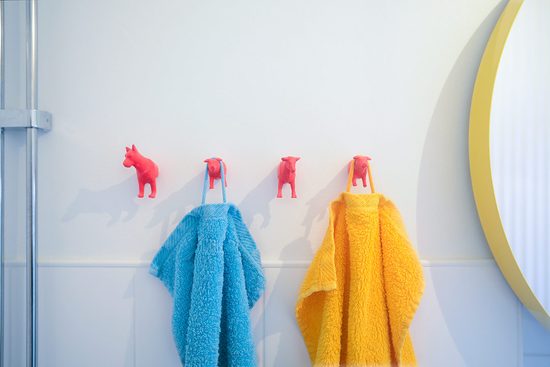DIY towel hooks made from plastic toy animals