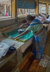 Woman ironing at Dhobi Khana