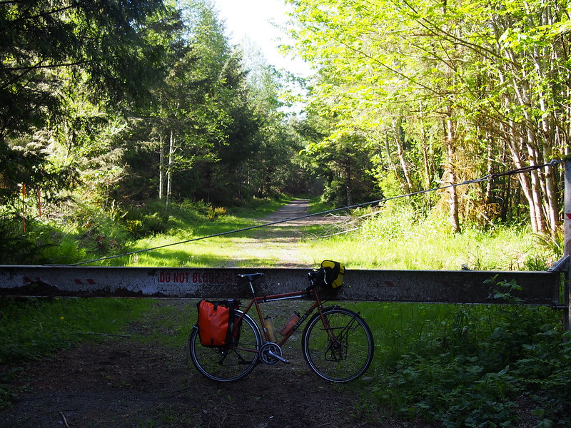 """""""AP Tubbs Road""""?: OpenStreetMap showed the road as being a significant bicycle route, and going through this property. In reality, I ended up having to do some underbiking to get through."""
