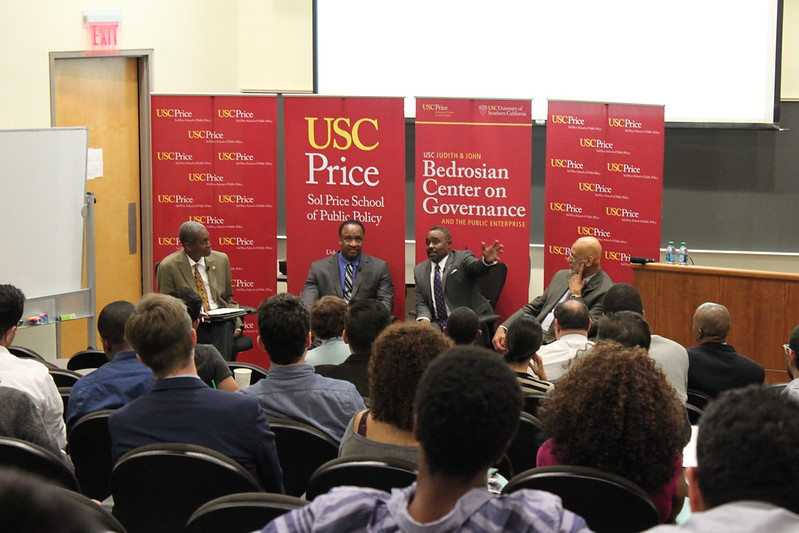 USC Price Professor Raphael Bostic, left, with the panelists