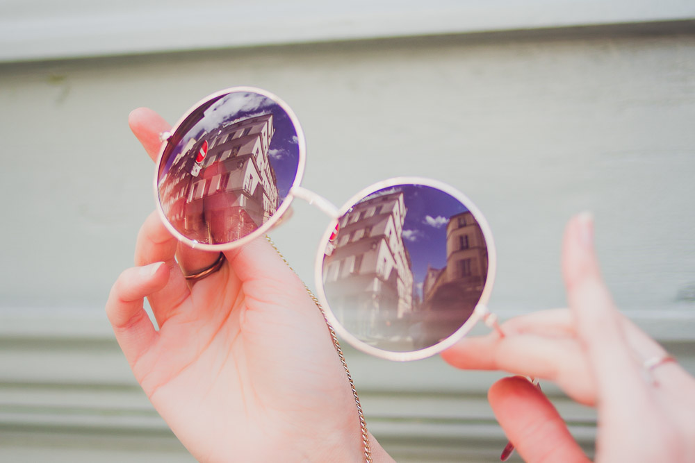 reflection of paris in rose tinted sunglasses