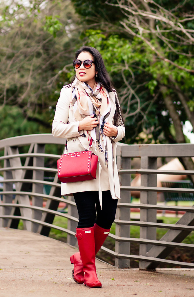 cute & little blog | petite fashion | classic double-breasted trench, burberry check summer scarf, black jeans, red hunter rain boots, red studded crossbody bag | rainy day spring outfit