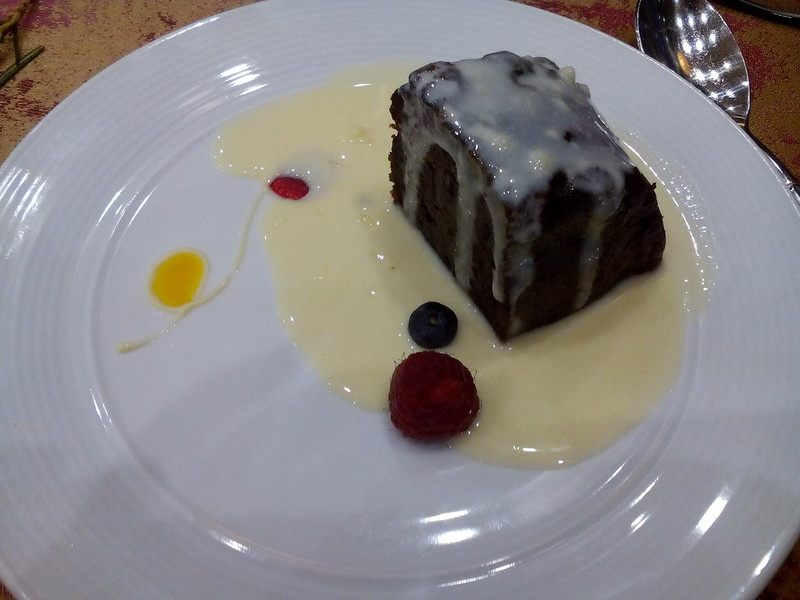 Dessert - Christmas pudding with vanilla sauce