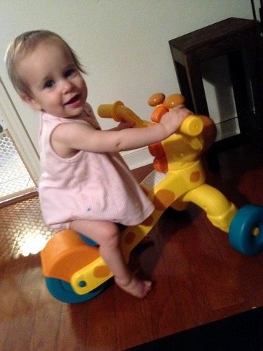 Riding her New Giraffe