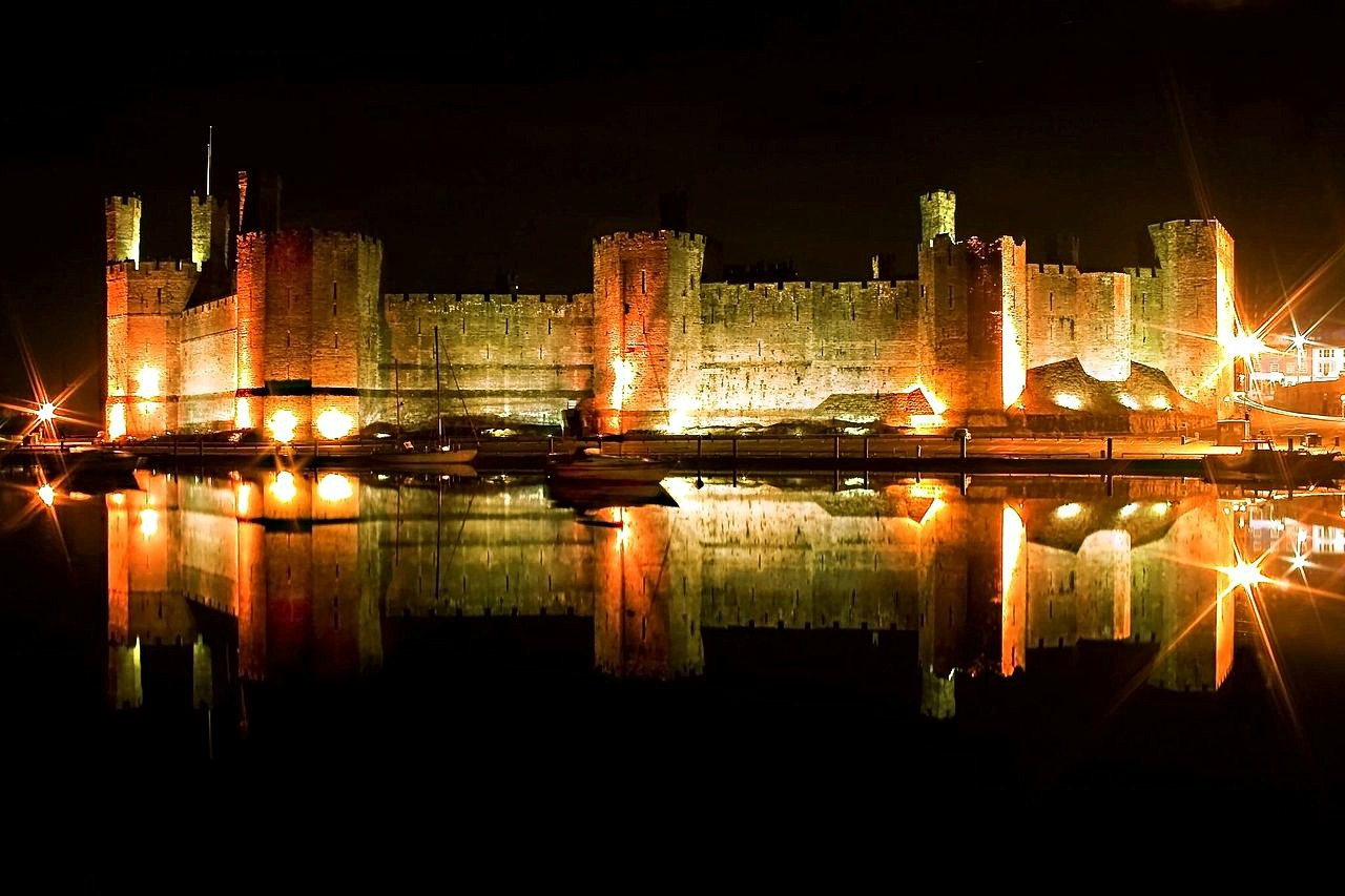 Caernarfon castle in calm conditions across the Seiont river. Credit Richard Outram