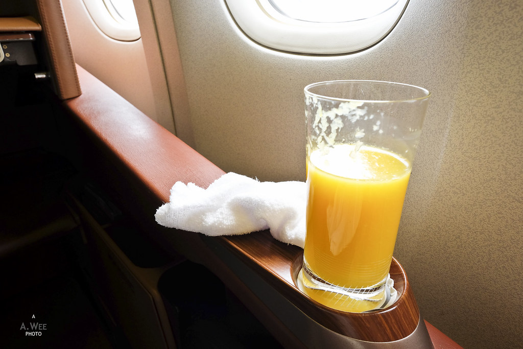 Orange juice and towel