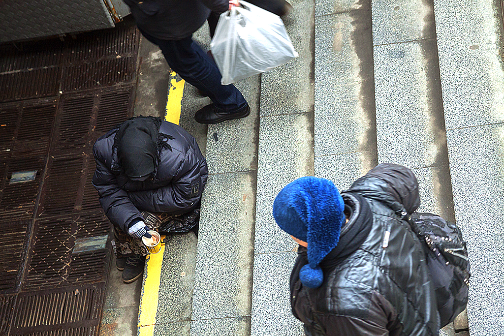 Woman begging at subway entrance--Kiev