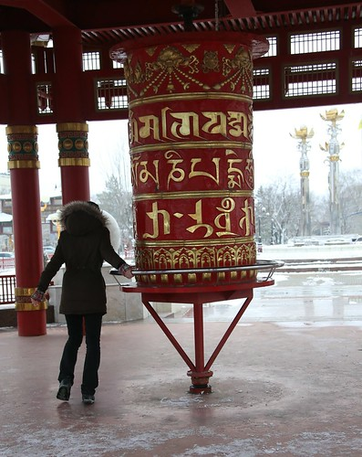 Sarah spinning the prayer wheel at Seven Days Pagoda