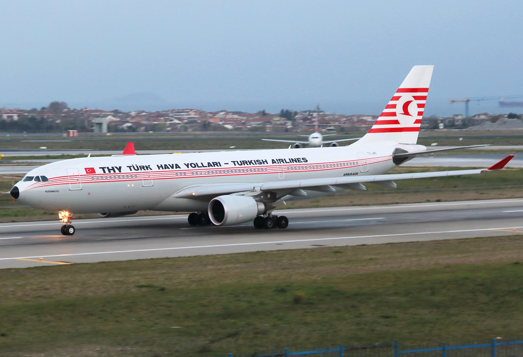 The beautiful retro is speeding up on RWY25L for departure to Antalya AYT minutes after sunset. Delivered 05/2006.