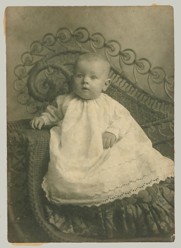 Baby and Wicker Chair