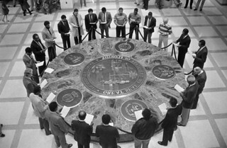 Men gather around the Florida Seal to honor Dr. Martin Luther King - Tallahassee