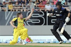Australia's James Faulkner bobbles the ball before taking the catch to dismiss New Zealand's Adam Milne for 14 in the first one-day international cricket match at Eden Park in Auckland