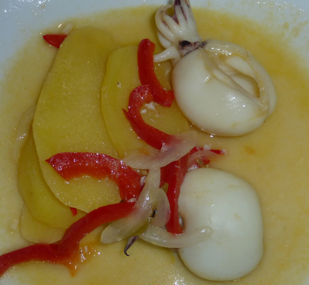 Cuttlefish stew layered with potatoes