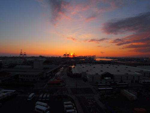 Aerial view of Sunset, Shipping Cranes, and Honolulu cityscape