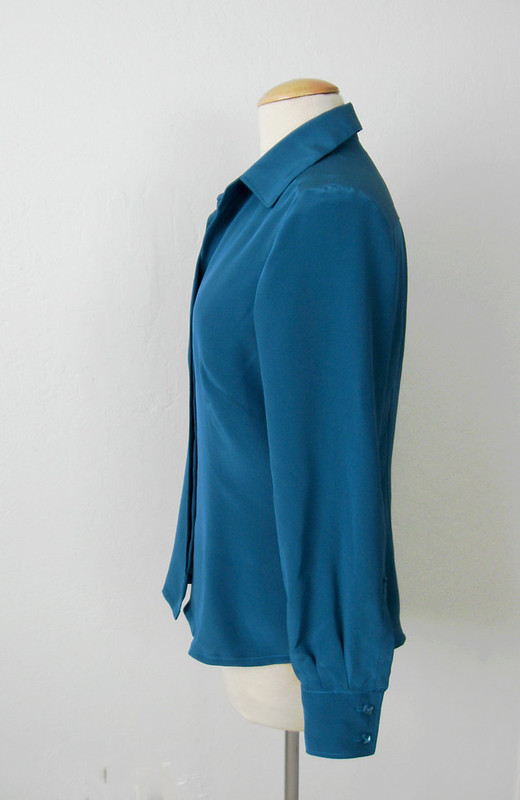 silk blouse side view on form