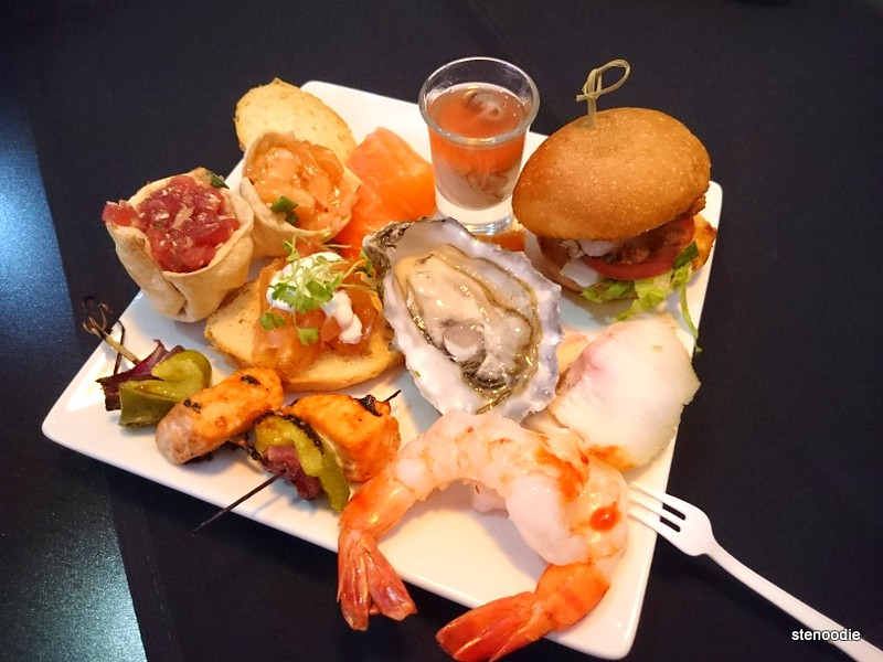 Seafood and cooked foods on plate