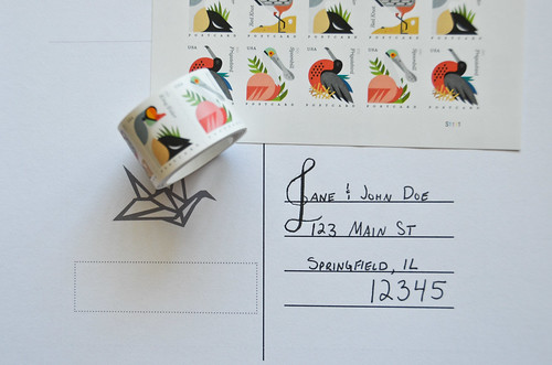 6 Apply theme-appropriate postcard stamps