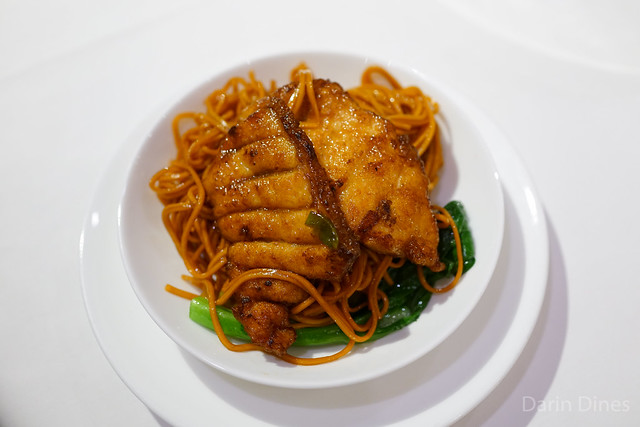 Pan-fried sliced garoupa with spring onion and soya sauce noodles