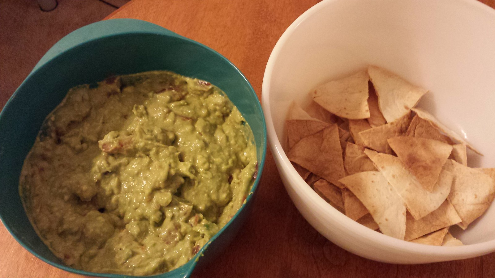 Homemade guacamole and roastewd tortilla chips.