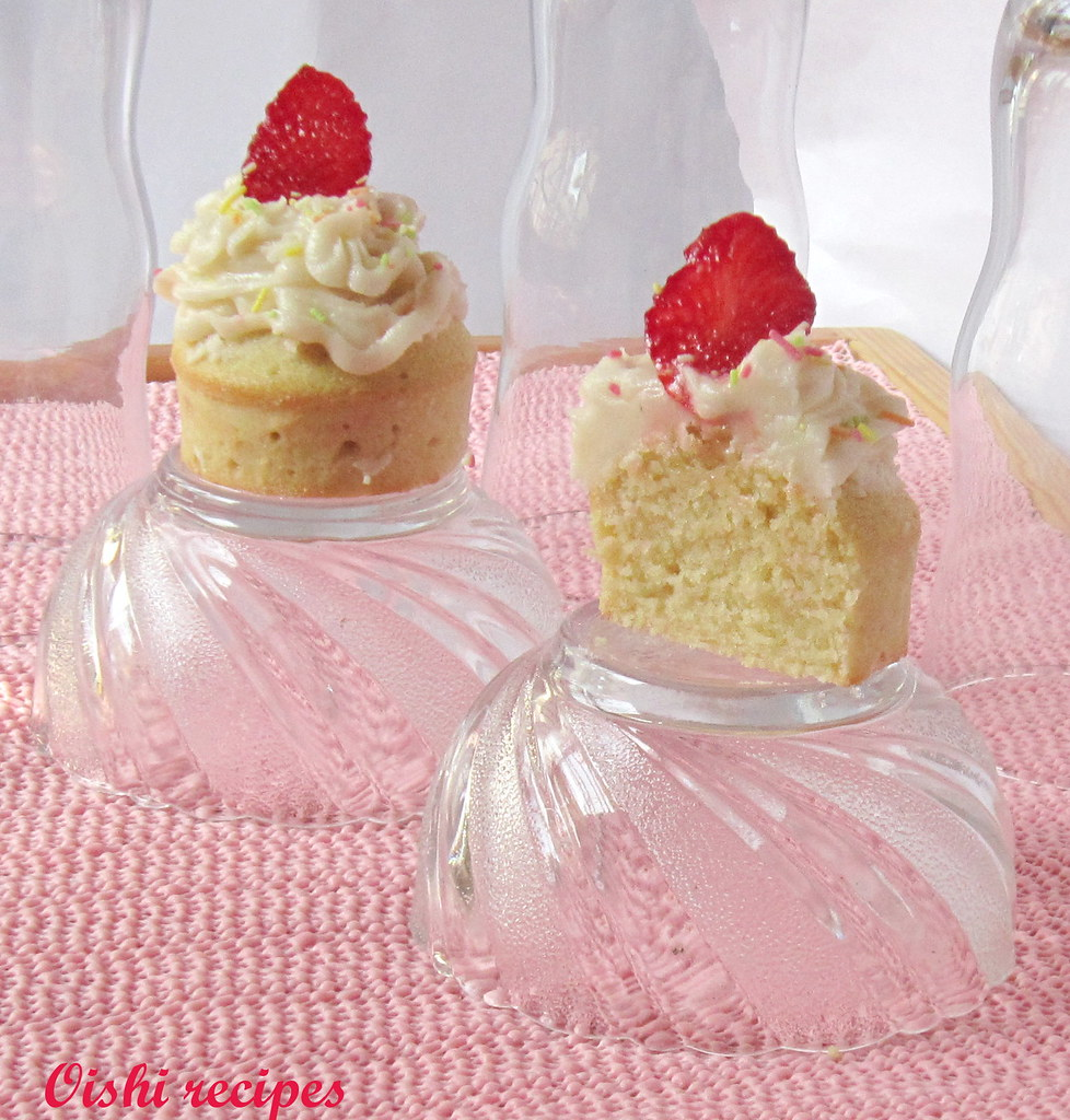 Vanilla cupcakes with buttercream frosting and Strawberry