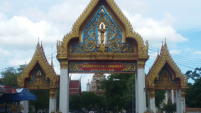 the gilded gateway of Wat Chalong, Phuket