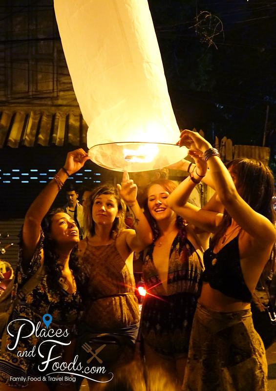 chiang mai loy krathong group of girls preparing lantern