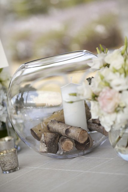 Candle in glass jar filled with woods for Wedding centerpieces for an outdoor rustic wedding | Photo by Blumenthal Photography | Read this real wedding on I take you - UK wedding blog
