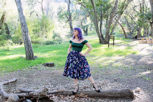 Pinup Girl Clothing Pinup Couture Peasant Top in Dark Green Pinup Couture Jenny Skirt in Floral Web Print
