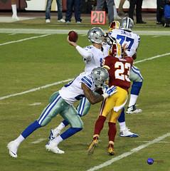 Cowboys RB Darren McFadden tries to block DB DeAngelo Hall.