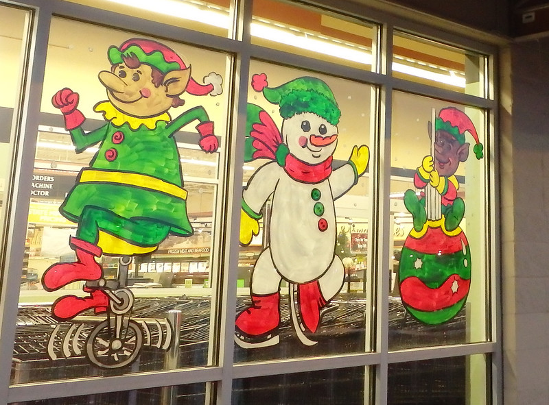 painting of two elves and a skating snowman