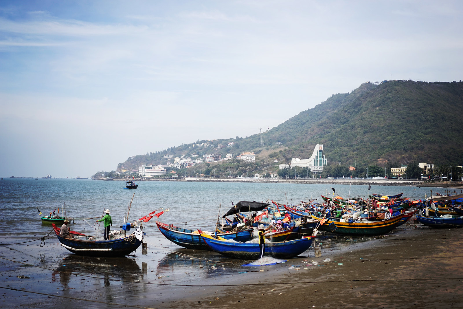 Fishing boats lining the shore of Vung Tau's Front Beach