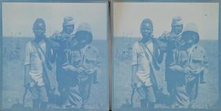 Jorma Gallen-Kallela, Nandi boy Kamaue and Jorma's gunbearer Kenosua return from a hunting trip.