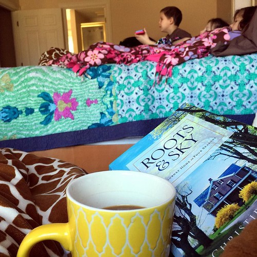 Saturday sweetness: third cup of coffee, kids snuggled up watching tv on my bed, slowly reading and underlining through Roots and Sky by @christiepurifoy. A delightful calm before the ordinary Saturday chores of groceries and errands and other family thin