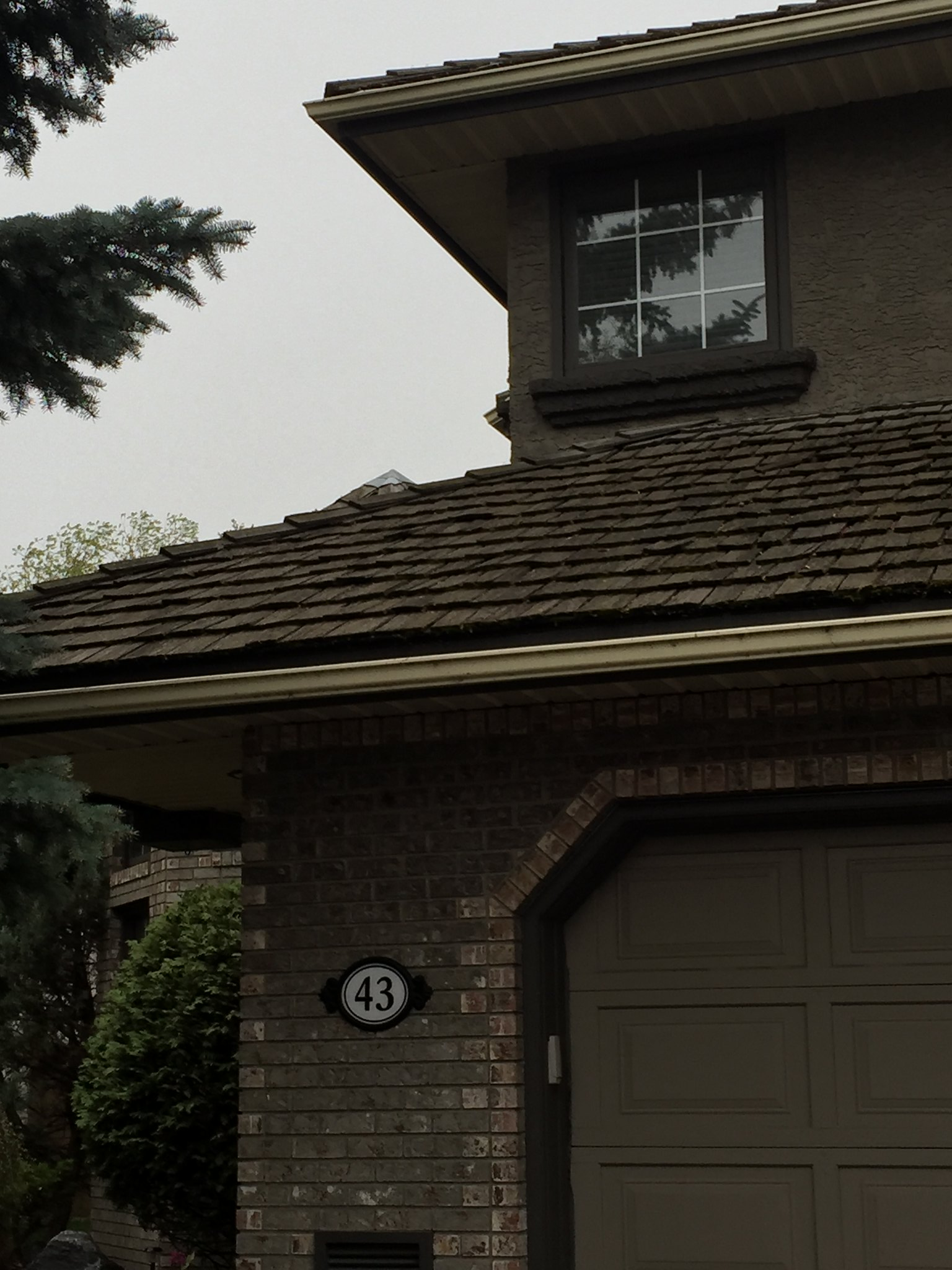 exterior of a home with beige brick and paint colour to match