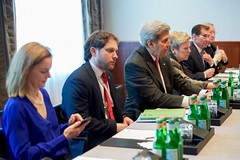 U.S. Secretary of State John Kerry - flanked by State Department Executive Assistant Lisa Kenna, State Department Chief of Staff Jon Finer, Under Secretary of State for Arms Control and International Security Rose Gottemoeller, State Department Spokesperson John Kirby, and Assistant to the Chairman of the Joint Chiefs of Staff Navy Admiral Frank Pandolfe - sits across from Republic of Korea Foreign Minister Yun Byung-Se on February 12, 2016, at The Charles Hotel in Munich, Germany, at the outset of a bilateral meeting on the margins of the Munich Security Council. [State Department photo/ Public Domain]