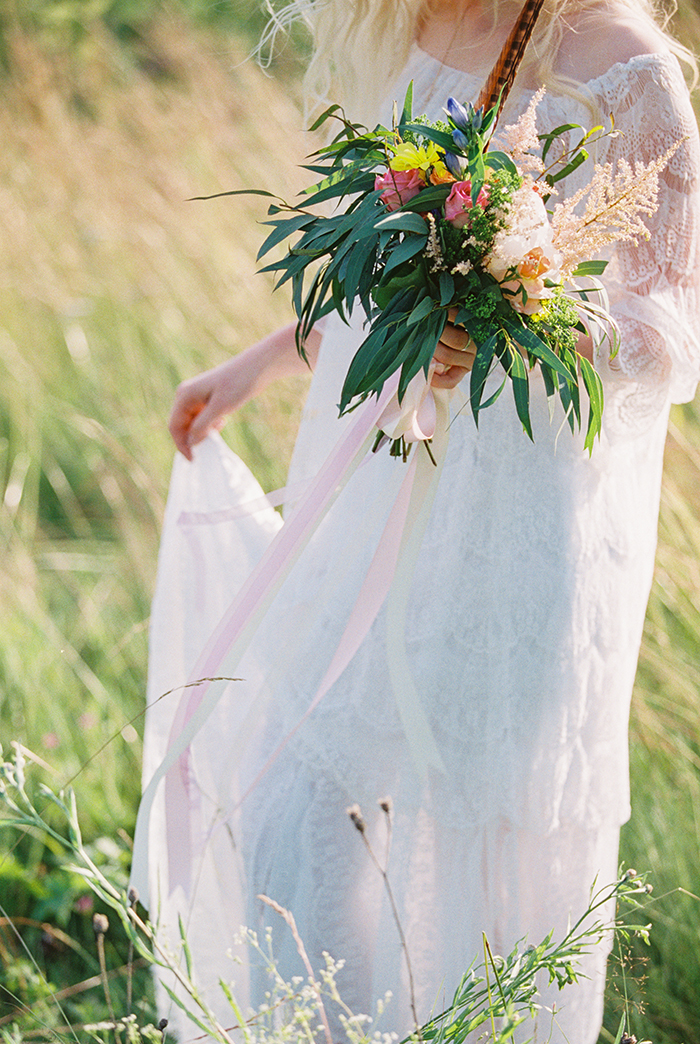 vibrant flowers + feather bouquet for Bohemian wedding inspiration shoot in the countryside with a dose of vibrancy | photo by Igor Kovchegin | http://www.fabmood.com/bohemian-wedding-inspiration-shoot/ Fab Mood - UK wedding blog #bohemian