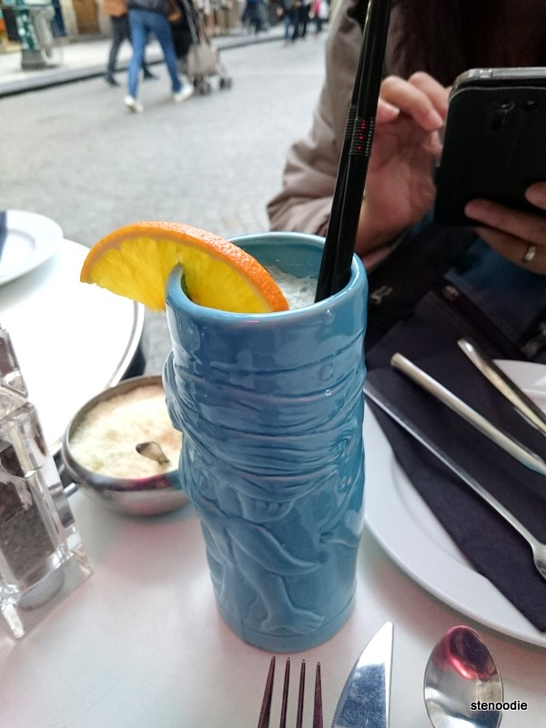 Ocean Kiss Cocktail in a tall blue mug