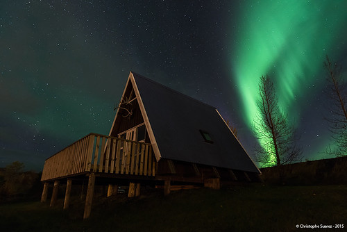 Northern lights over a typical islandic house