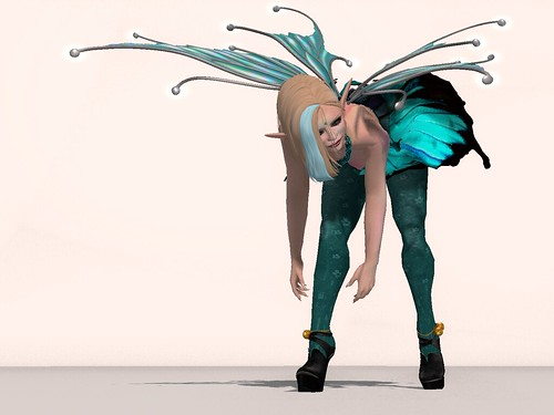 image Description: Deoridhe in teal bends over, reaching for one of her feet.