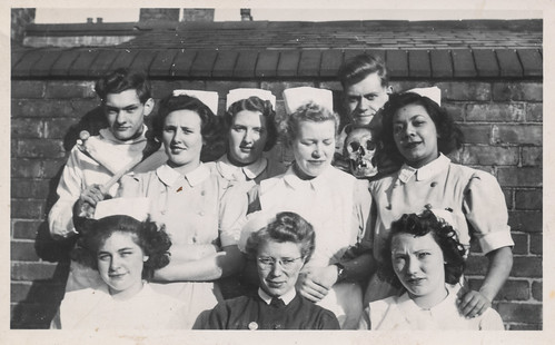 Group of nurses posing with a skull and bones