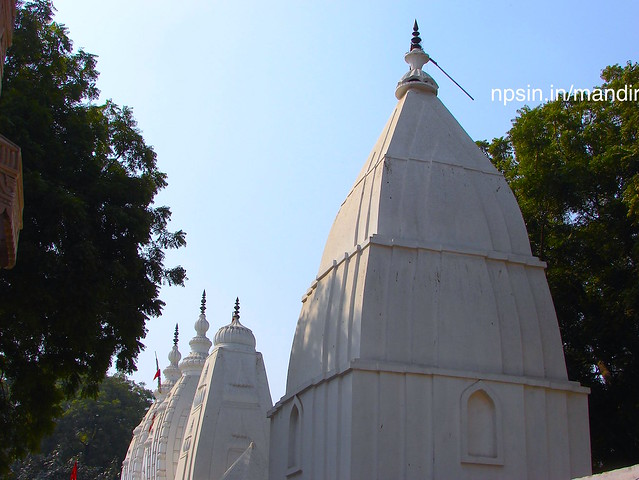 The series of four consecutive white colored temples with beautiful side view from main prayer hall side.