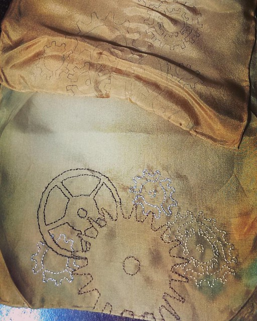 Clockwork handembroidered silk scarf, in progress.  One end finished, on to the other.  #silk #embroidery #handmade #handembroidered #clockwork #steampunk #silkscarf #scarf #handdyed #dantesspirit
