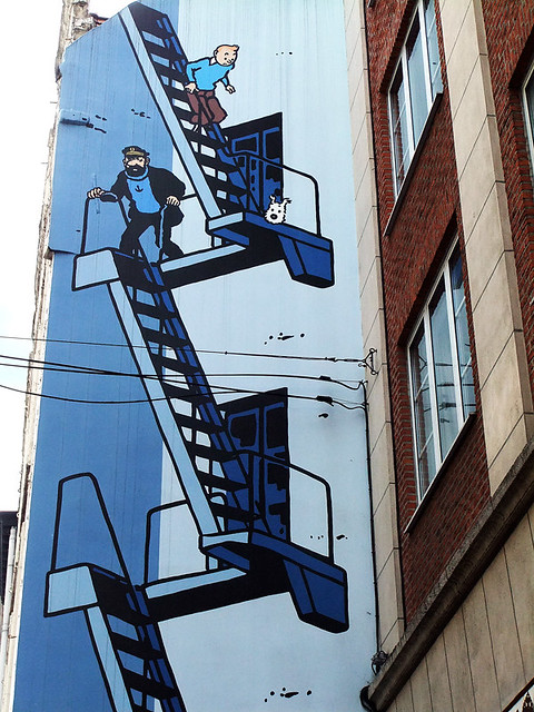 One of many cartoon murals on a wall in Brussels, Belgium, this one of the most famous Tintin