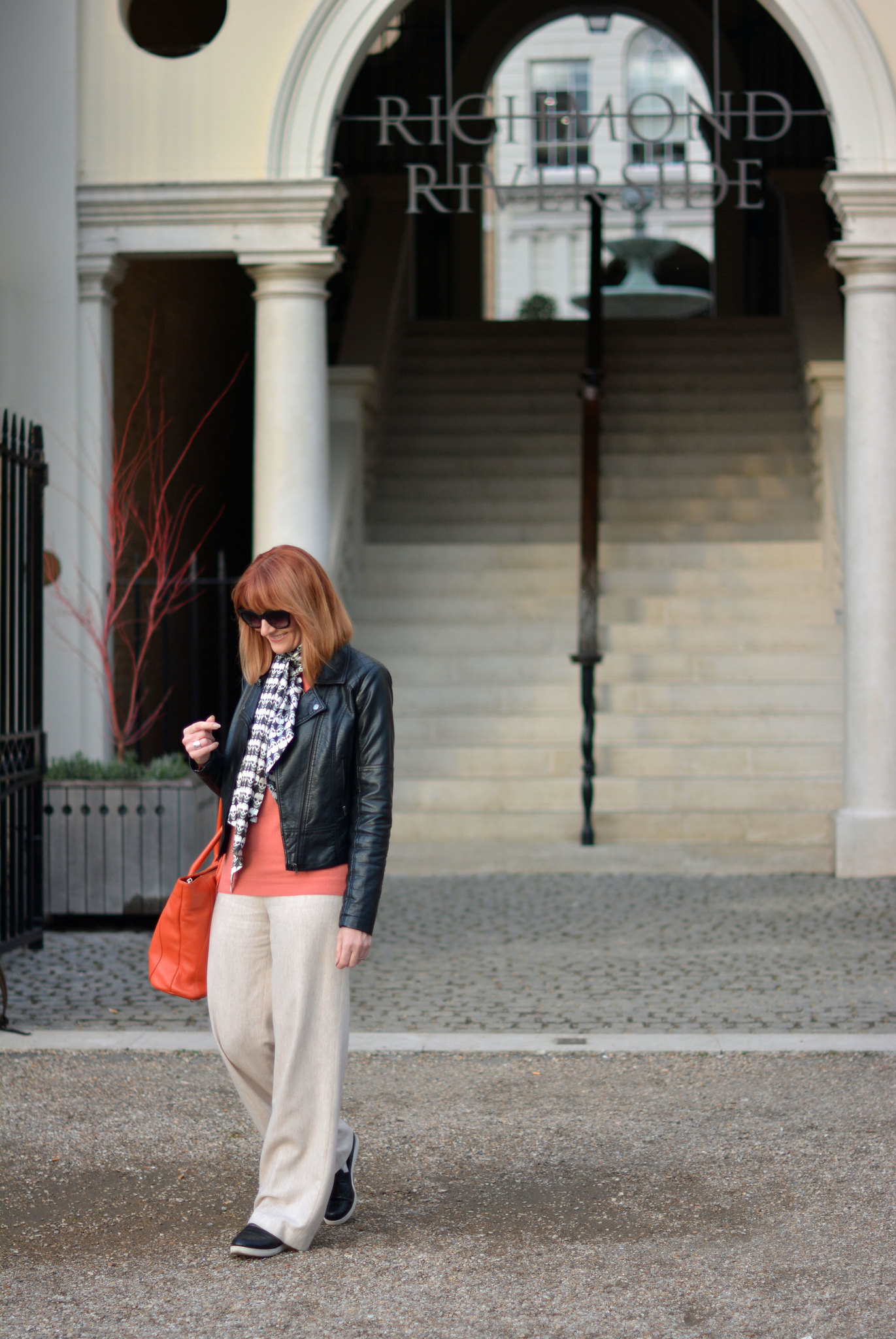 Bold orange, black and cream - Biker jacket, skull scarf, coral sweater, wide legged trousers, orange tote | Not Dressed As Lamb