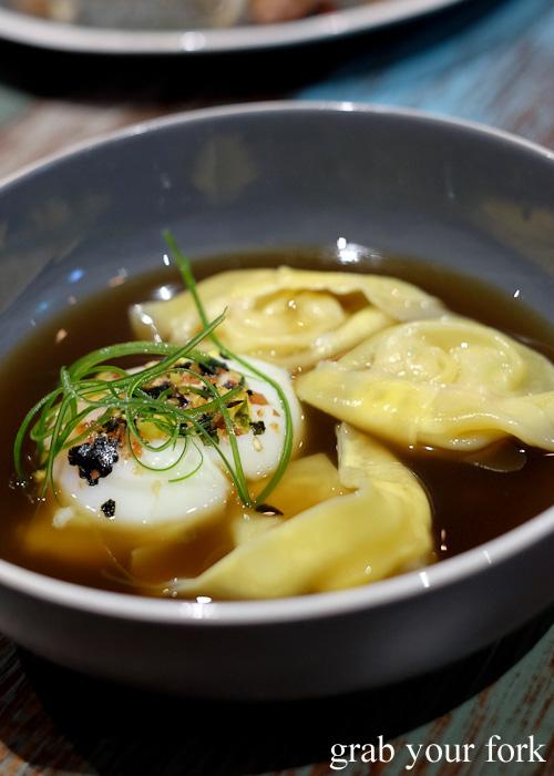 Poached QLD banana prawn and corn wonton with ramen broth and onsen egg at Yang and Co Castlecrag
