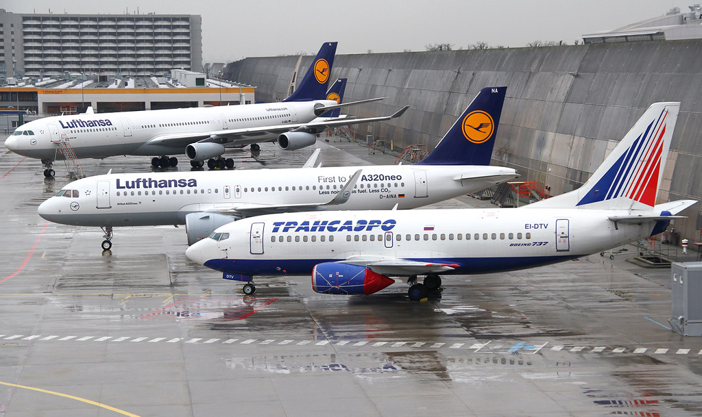 Interesting line-up of old and new planes on the tarmac of Lufthansa Technic. Transaero's EI-DTV is stored awating it's fate, the brand new A320NEO D-AINA is ready for the next flight and the old A340 D-AIGL is getting some maintenance. In the distance is D-ABIW, a B735 that will be scrapped soon.