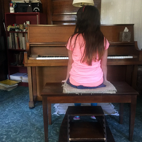 Julia at the piano at Mr. Palmer's Studio