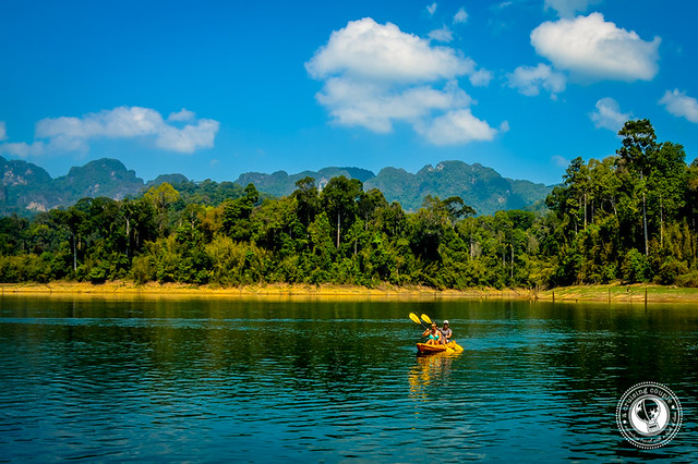 A Cruising Couple Kayaking in Khao Sok National Park Thailand